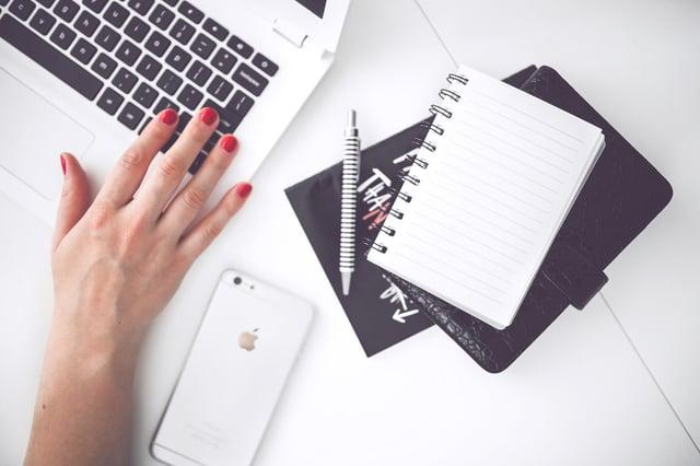 woman-hand-smartphone-desk.jpg